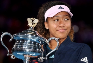 Tennis - Australian Open - Women's Singles Final - Melbourne Park, Melbourne, Australia, January 26, 2019. Japan's Naomi Osaka poses with the trophy after winning her match against Czech Republic's Petra Kvitova. REUTERS/Lucy Nicholson - UP1EF1Q0WDCK2